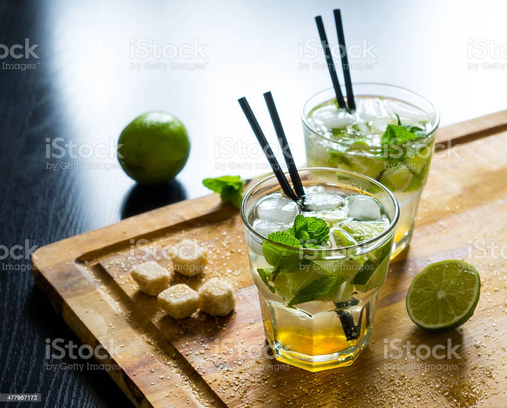 Fresh mojito drink on the wooden table stock photo