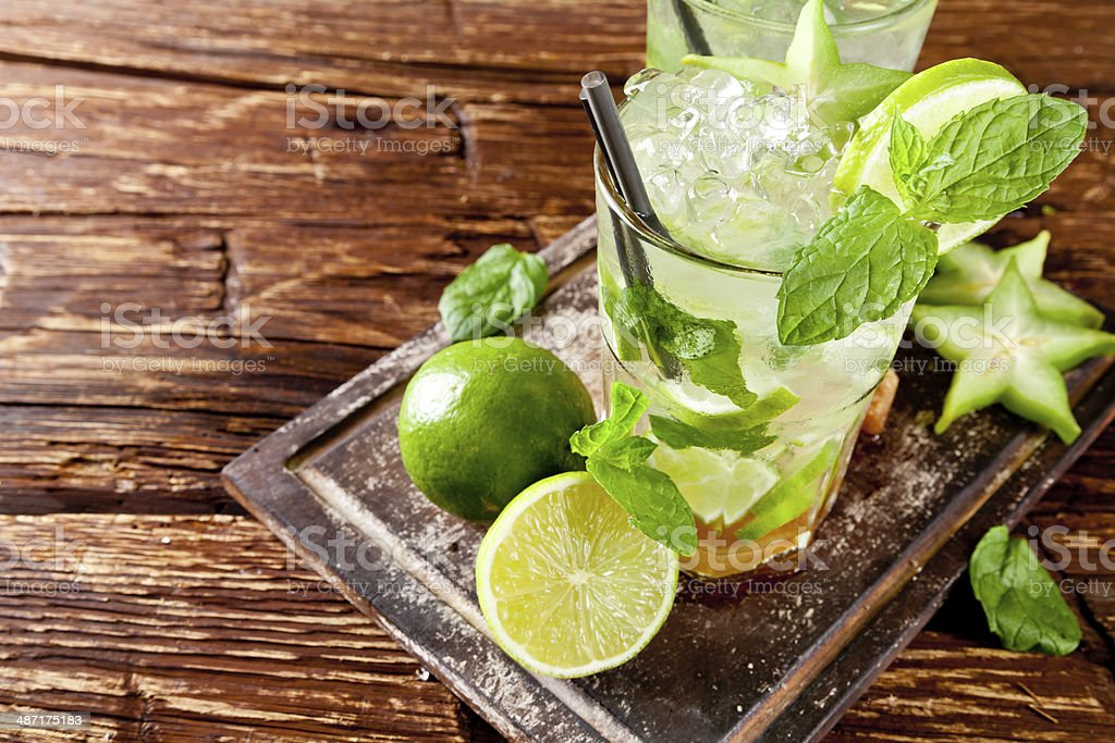Fresh mojito drinks on wooden background stock photo