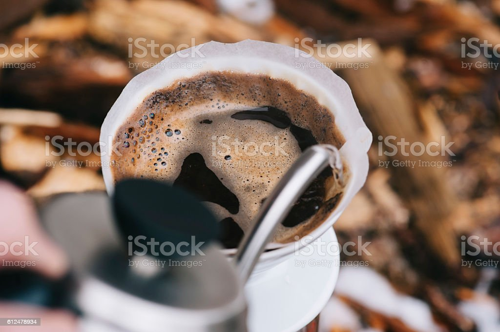 Fresh morning pour over coffee blossoms in the dripper stock photo