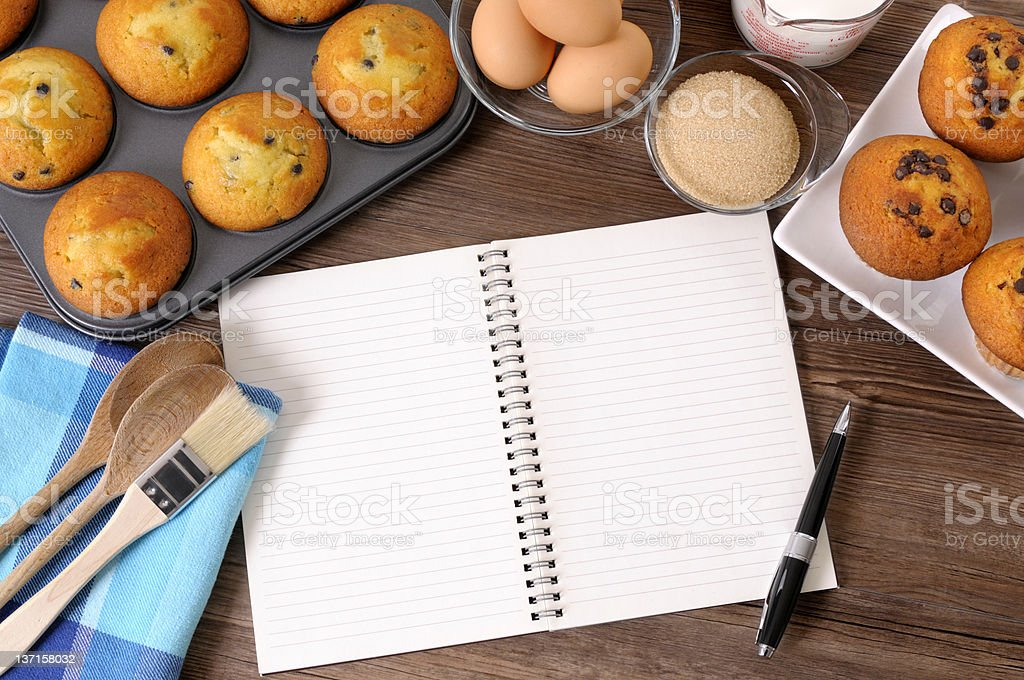 Fresh muffins with blank notebook royalty-free stock photo