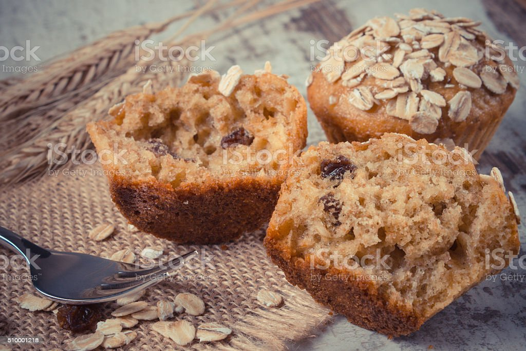 Fresh muffins with oatmeal and ears of rye grain stock photo
