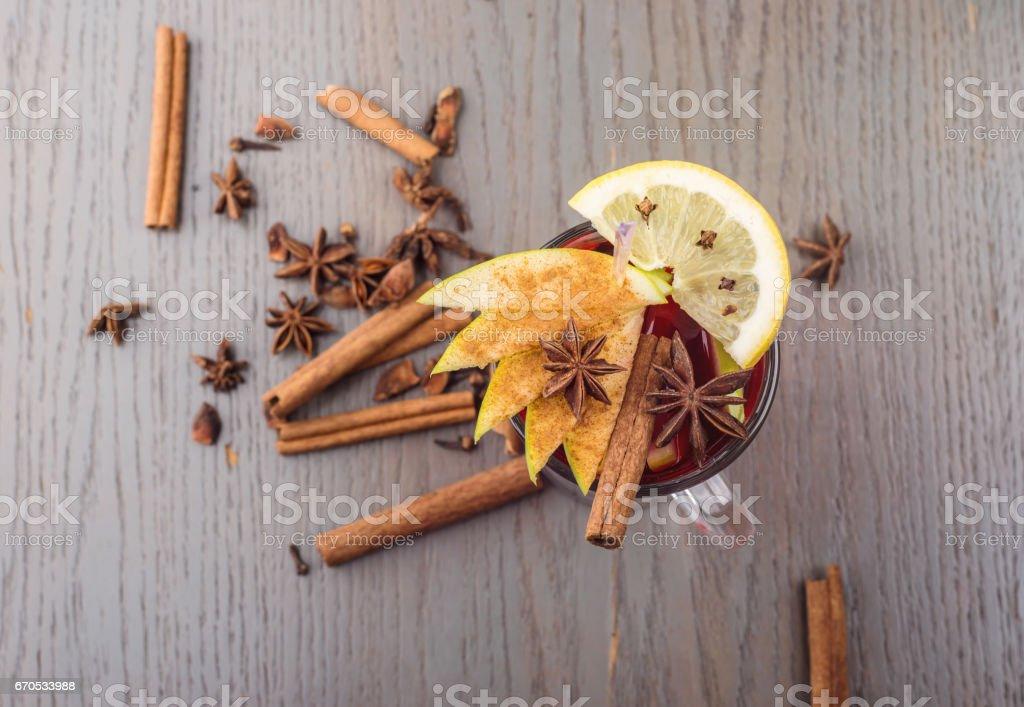 Fresh mulled wine, lemon, and anise stock photo