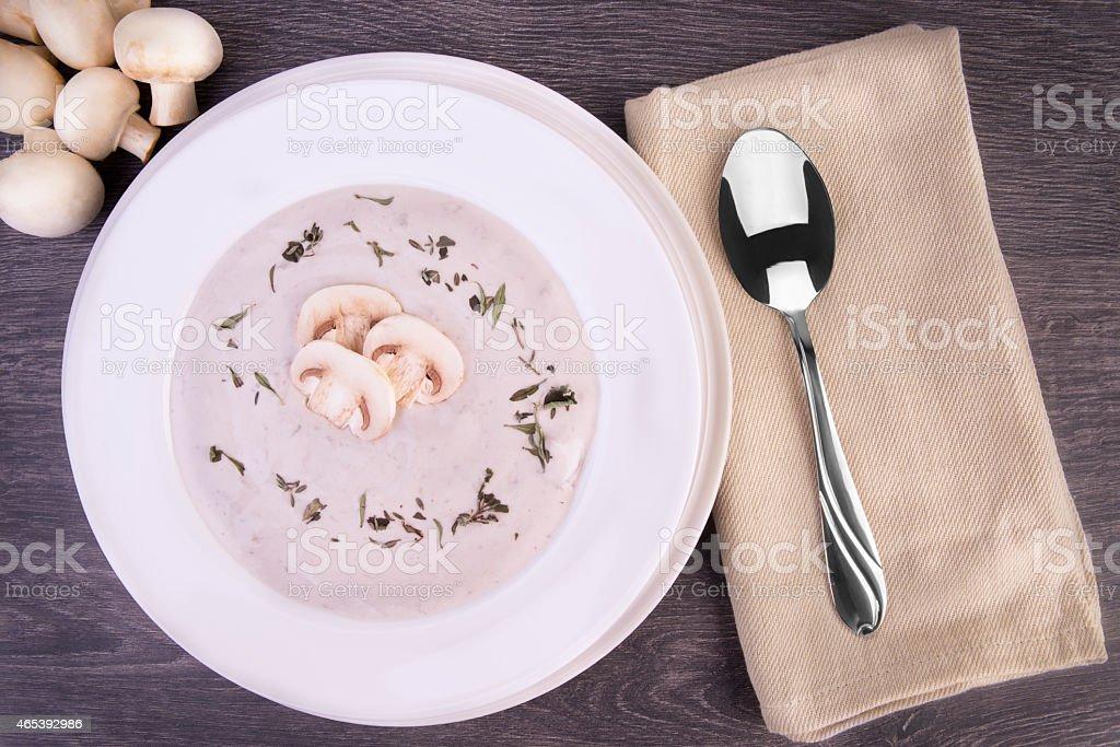 Fresh mushroom soup in a white bowl stock photo