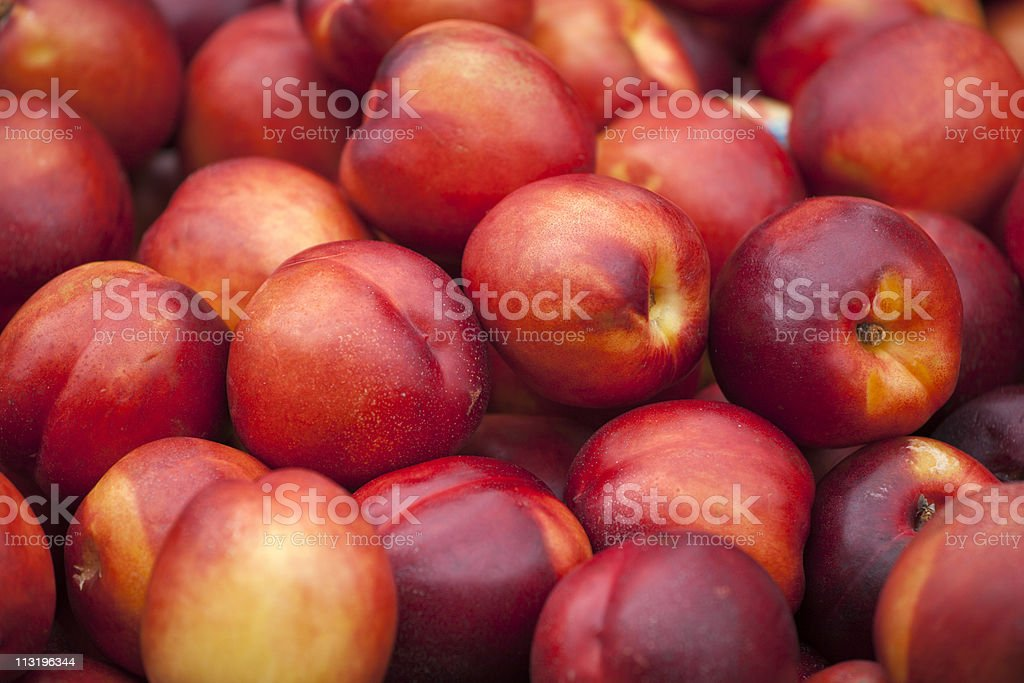 Fresh nektarine on the market stock photo