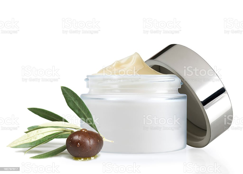 A fresh new open olive oil face cream royalty-free stock photo