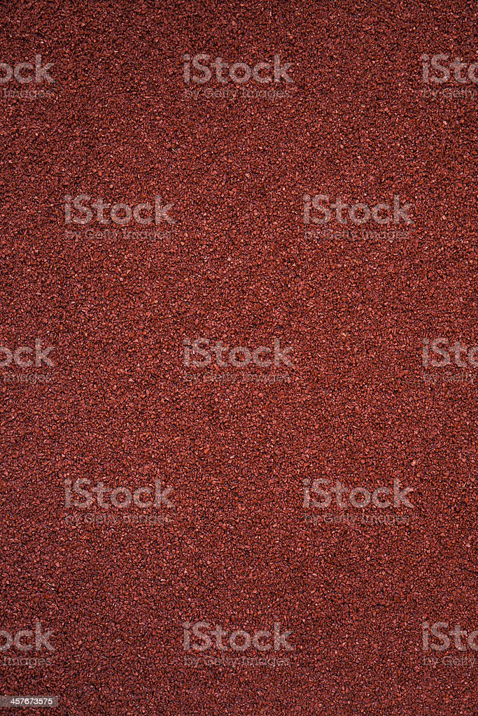 A fresh new red clay running track with rough grip texture stock photo