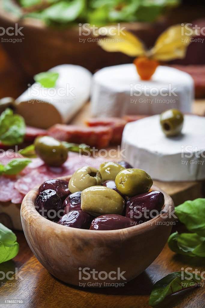 Fresh olives with antipasto catering platter royalty-free stock photo