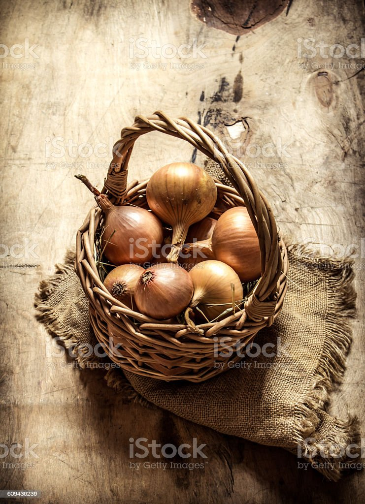 Fresh onion in an old basket. stock photo