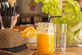fresh orange juice and holiday hat