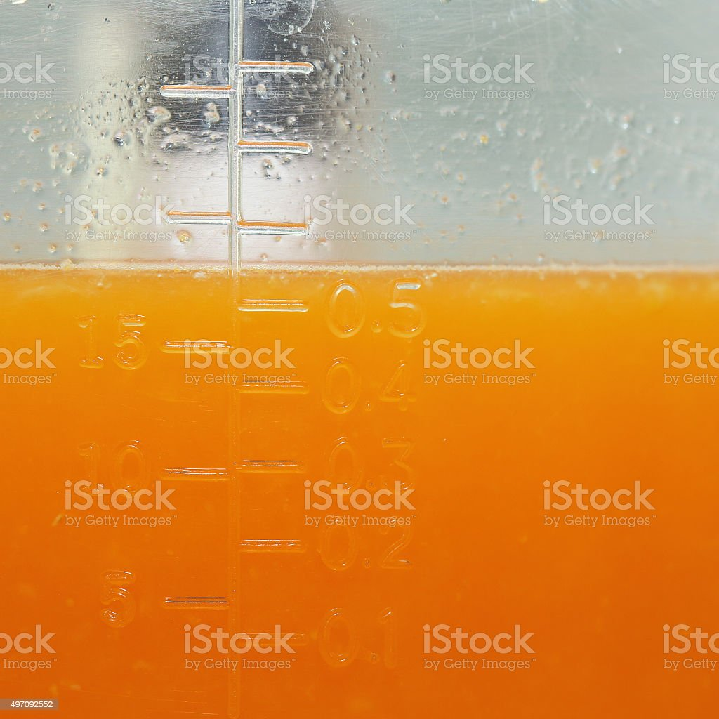 fresh orange juice in the jug measure stock photo