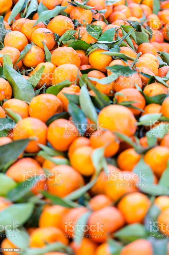 Fresh orange mandarines with green leaves stock photo