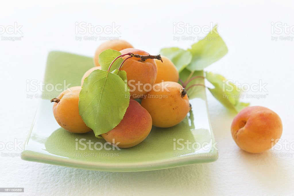 Fresh, Organic Apricots on a Green Plate royalty-free stock photo