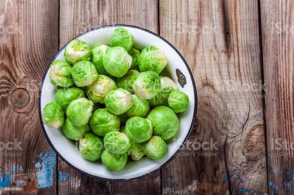 Fresh organic Brussels sprouts in a bowl stock photo