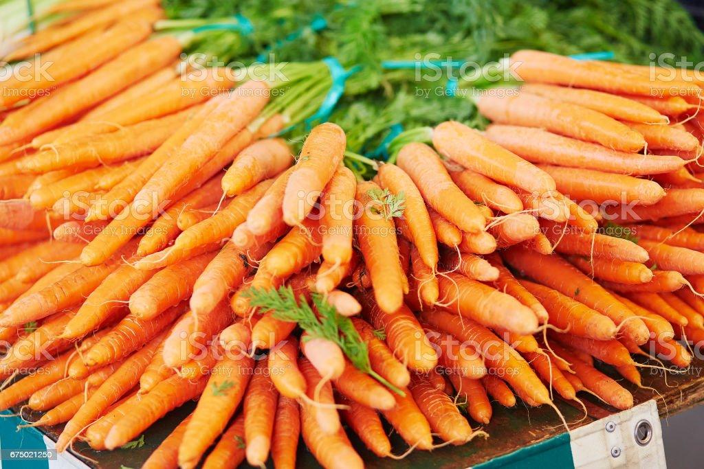 Fresh organic carrot on farmers market stock photo