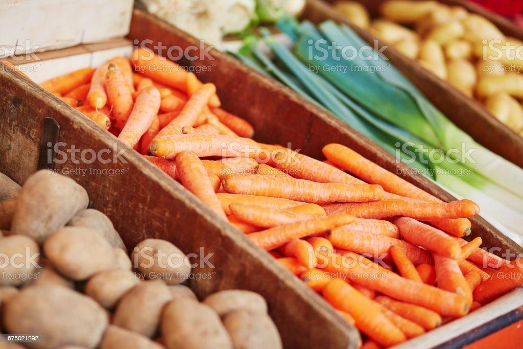 Fresh organic carrot, potato and leek on farmers market stock photo