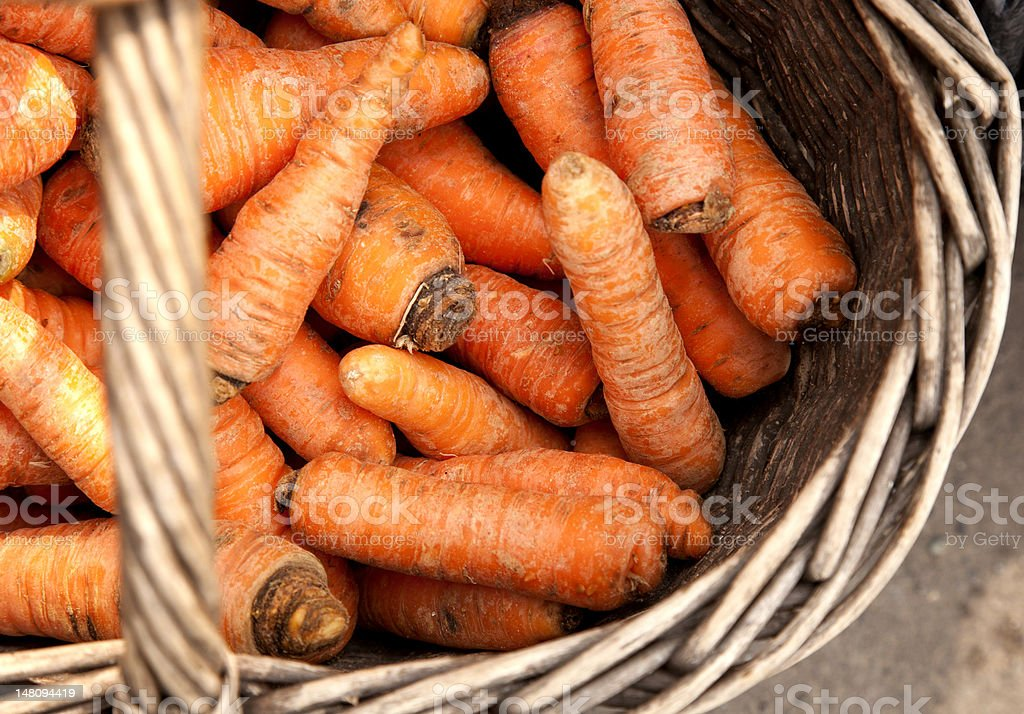 Fresh organic carrots in a wooden royalty-free stock photo