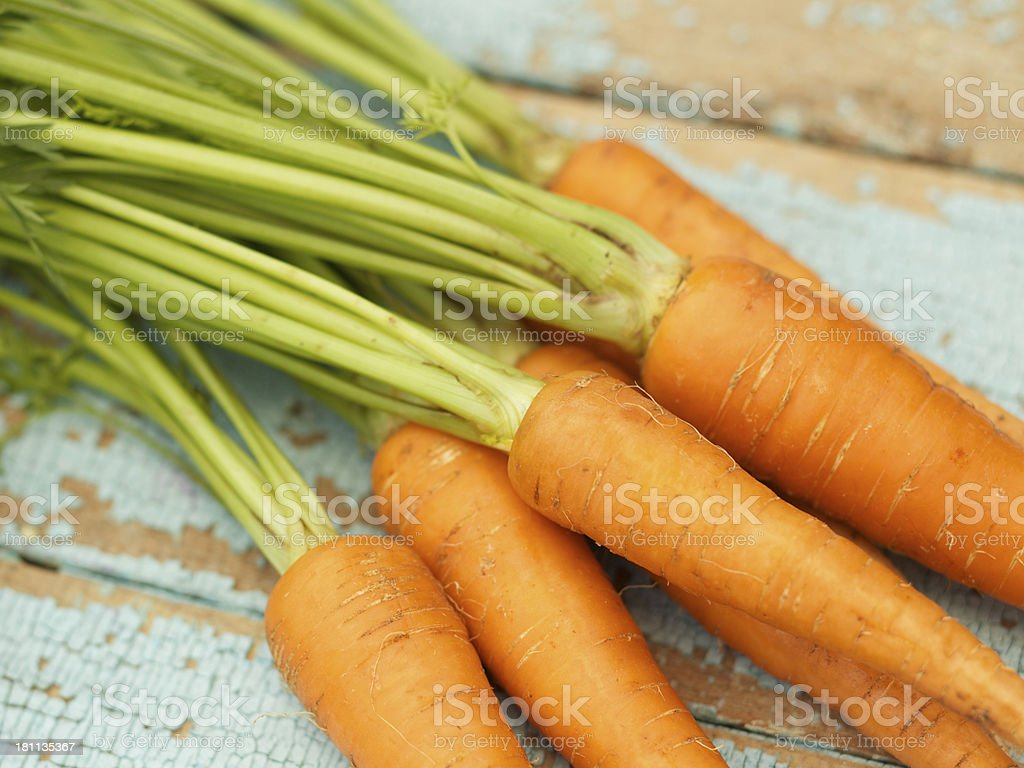 Fresh organic carrots on rustic wood table royalty-free stock photo