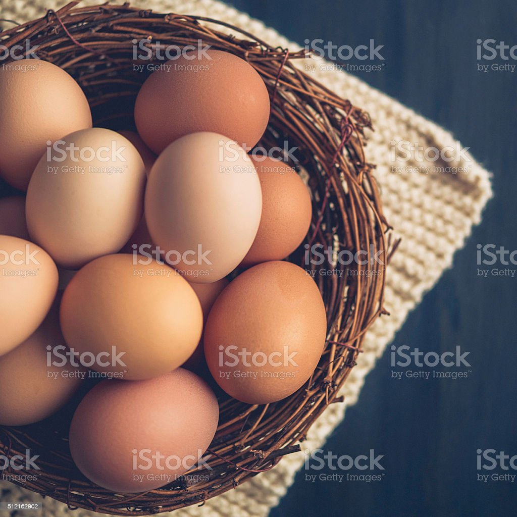 Fresh organic free range eggs in bowls with towel stock photo