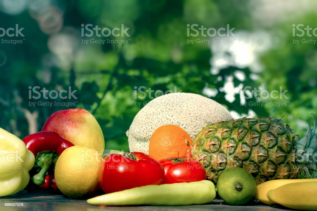 Fresh organic fruit and vegetable on table outdoors stock photo