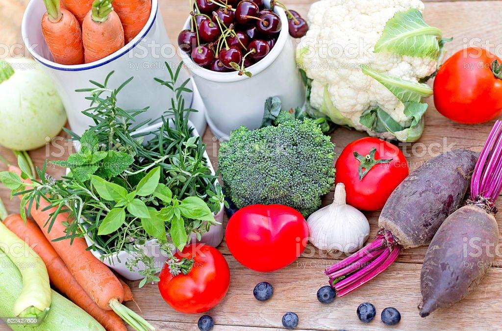 Fresh organic fruits, vegetables and fresh herbs stock photo