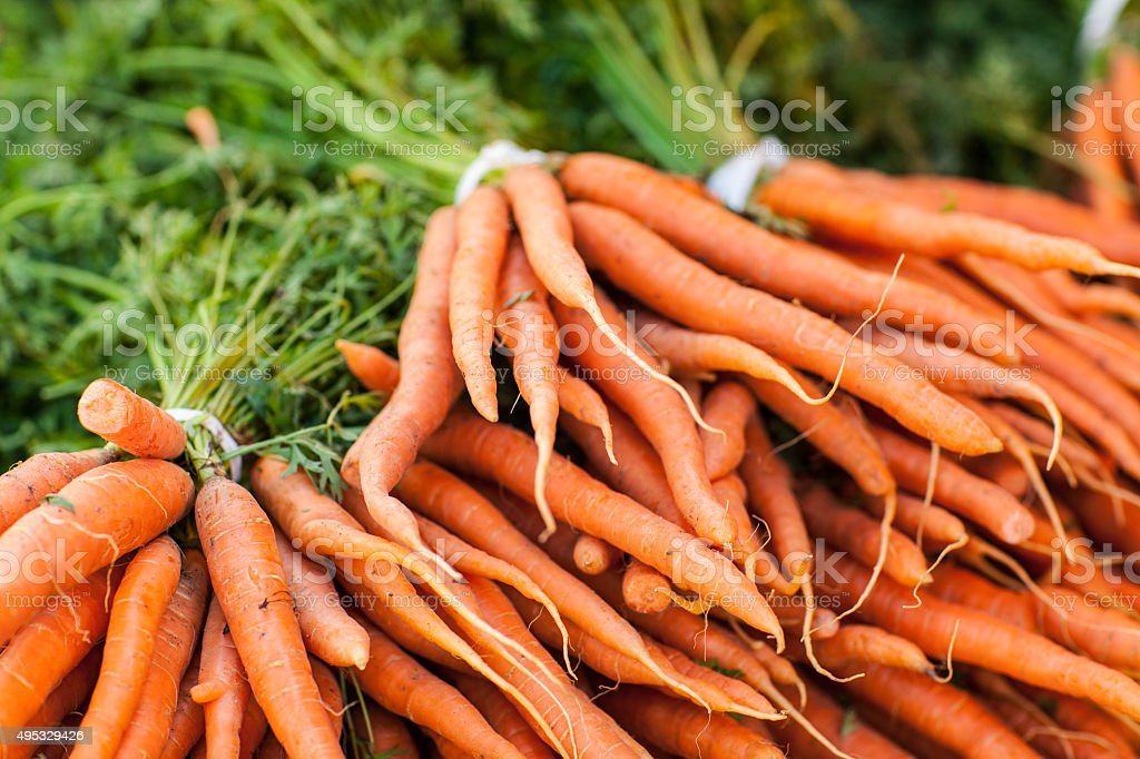 Fresh organic heirloom carrots at farmers market stock photo