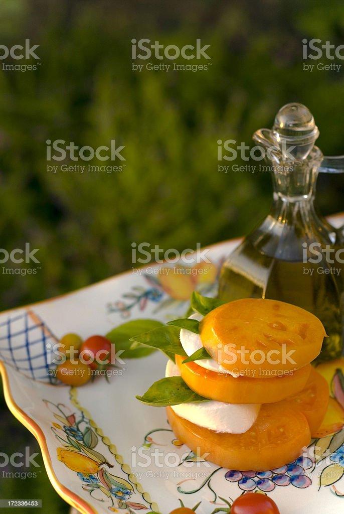 Fresh Organic Heirloom Tomato Caprese Salad: Homegrown Produce & Olive Oil royalty-free stock photo