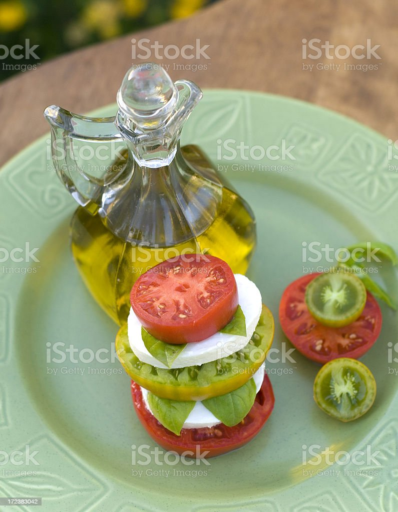 Fresh Organic Heirloom Tomato Caprese Salad: Homegrown Produce & Olive Oil royalty-free stock photo