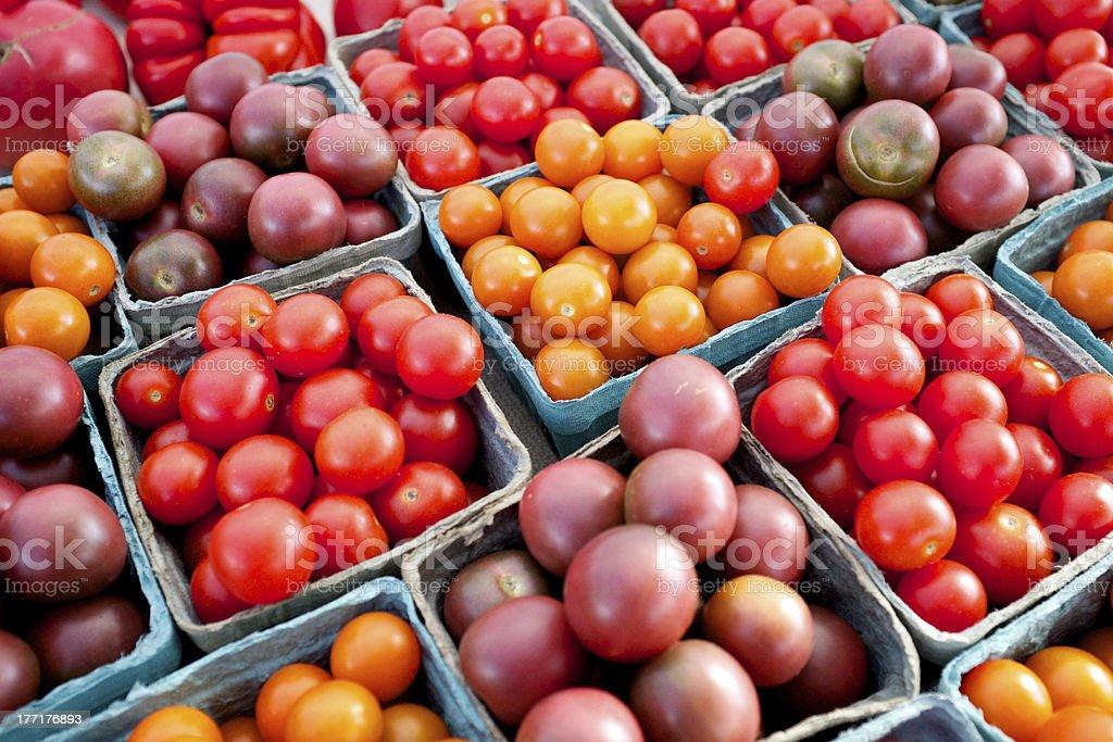 Fresh organic heirloom tomatoes at a farmers market royalty-free stock photo