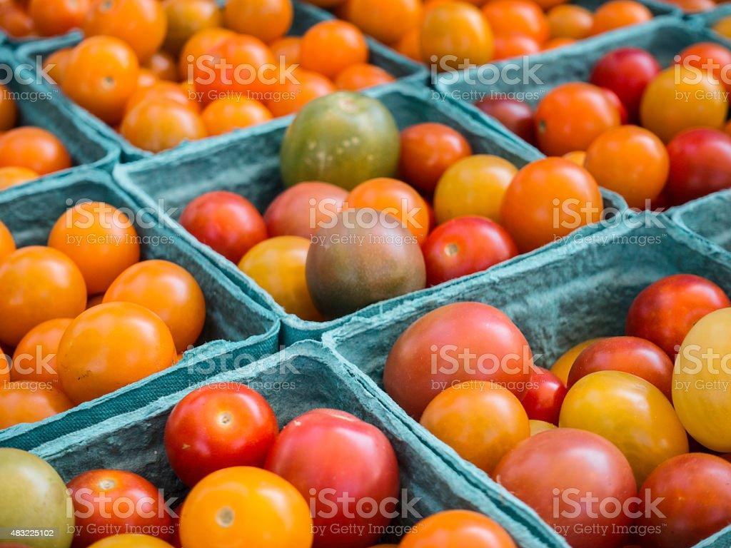 Fresh organic heirloom tomatoes at a farmers market stock photo