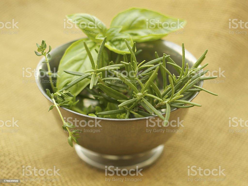Fresh organic herbs in antique metal bowl royalty-free stock photo