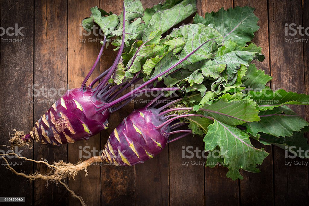 Fresh organic kohlrabi on the wooden table stock photo