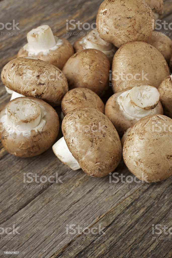 Fresh organic mushrooms on rustic table stock photo