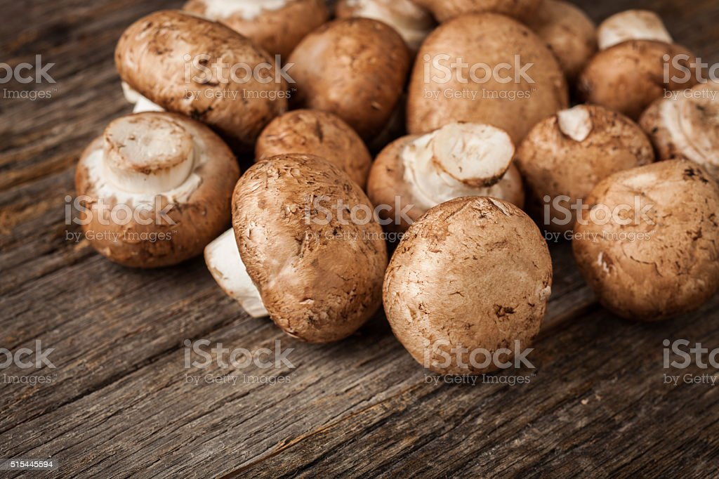 Fresh organic mushrooms on rustic table stock photo