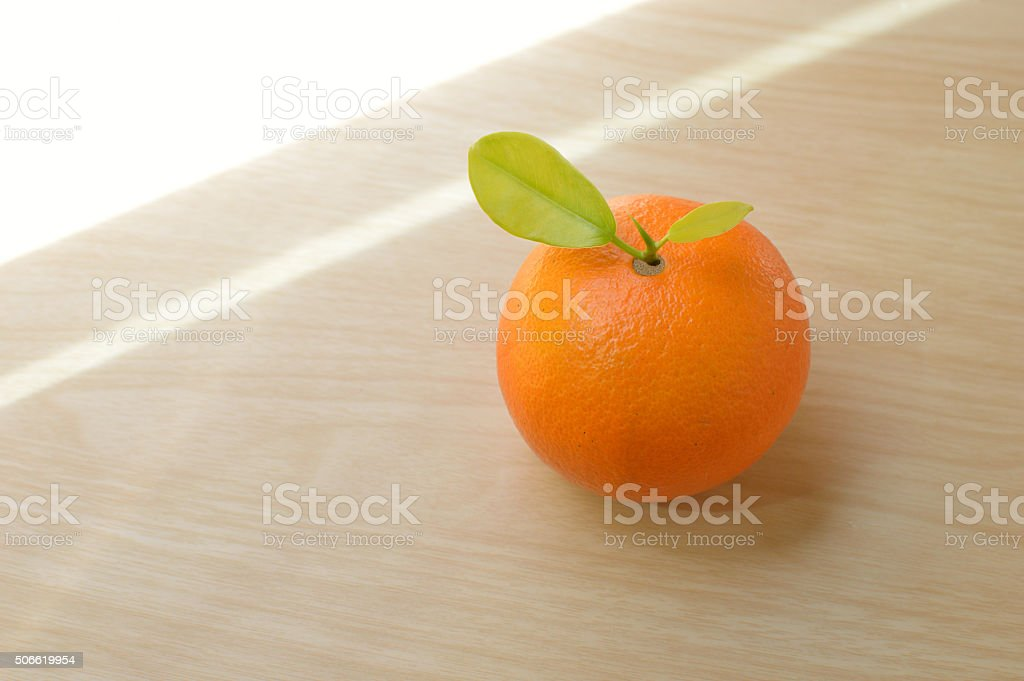 Fresh organic oranges fruits on wooden table stock photo
