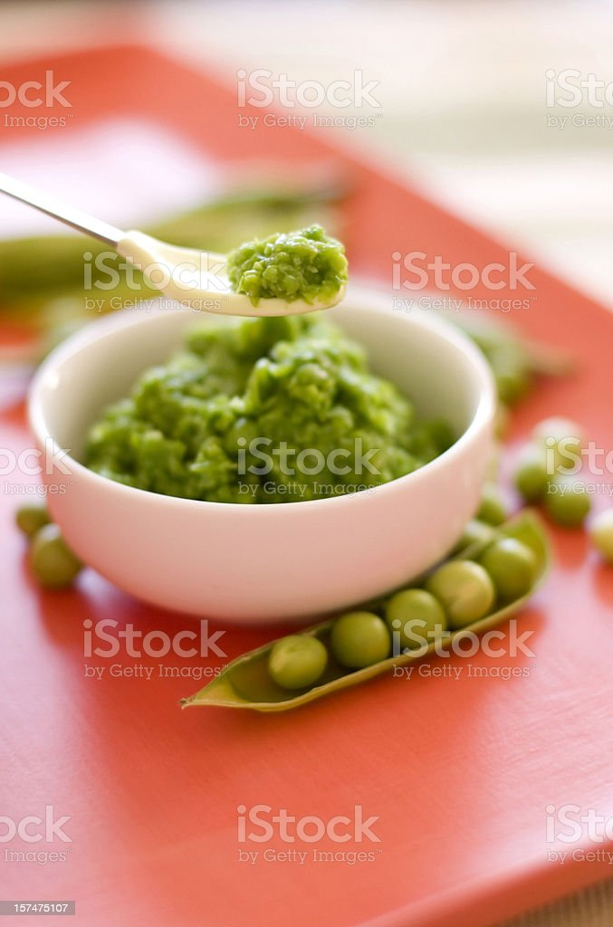 Fresh, Organic Pureed peas for baby stock photo