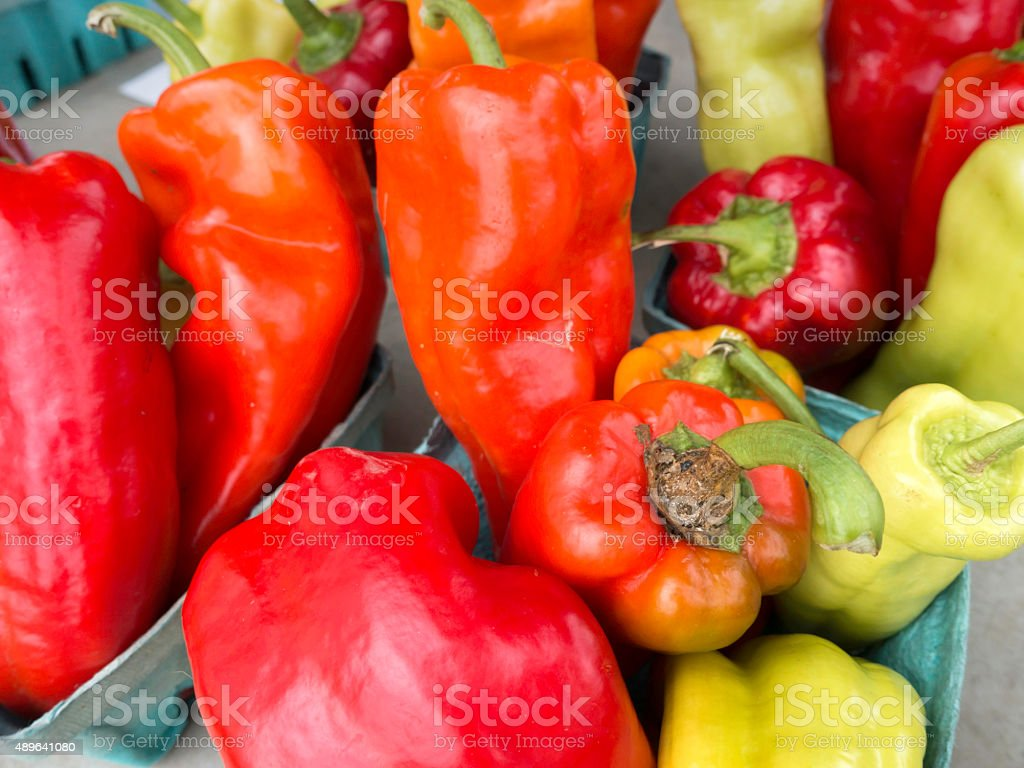 Fresh organic roasting peppers at a farmers market stock photo