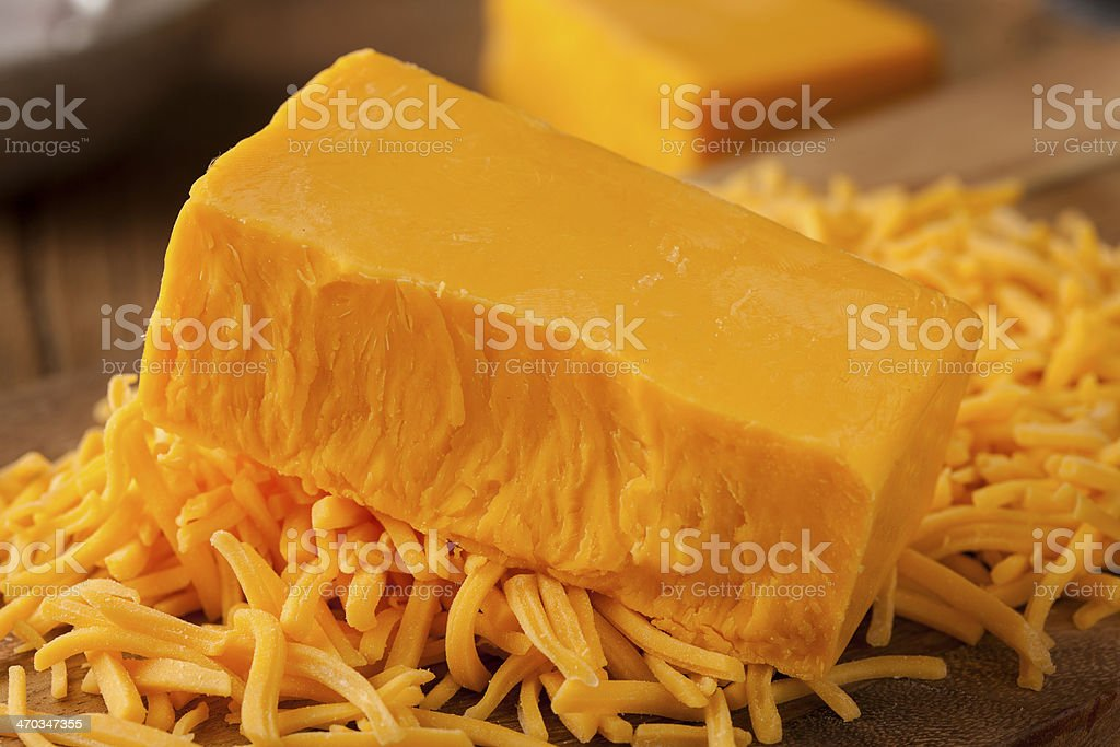 Fresh organic sharp cheddar cheese stock photo