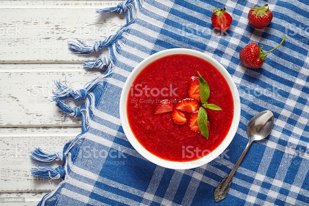 Fresh organic strawberry cream soup vegetarian cold sweet berry smoothie stock photo
