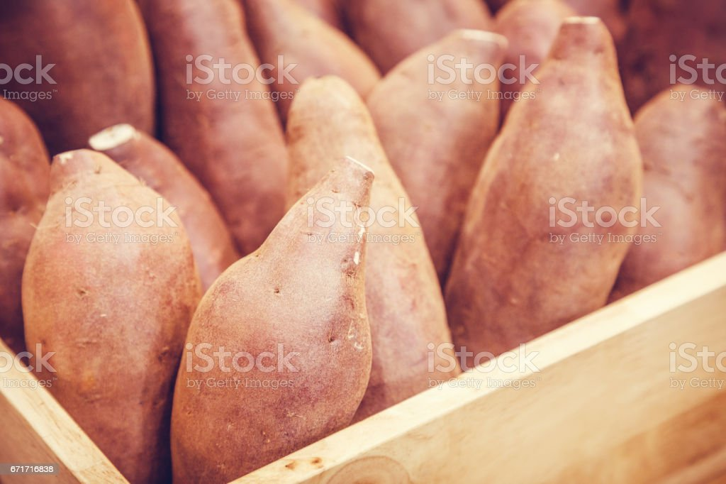fresh organic sweet potato in the wooden crate. stock photo