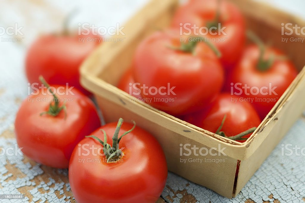 Fresh organic tomatoes on rustic blue table royalty-free stock photo