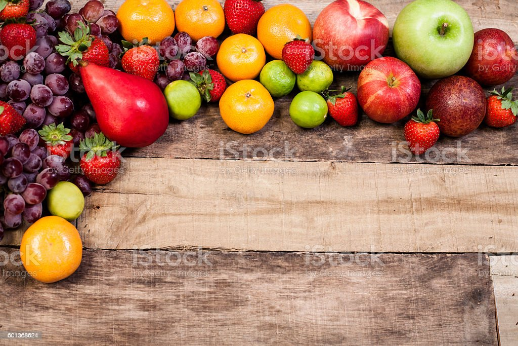 Fresh, organic variation of colorful fruits on rustic wooden table. stock photo
