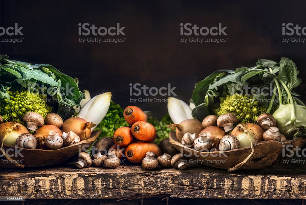 Fresh organic vegetables from garden on old rustic wooden table stock photo