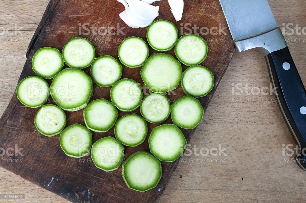Fresh Organic Vegetables in Preparation for Zucchini Dish stock photo