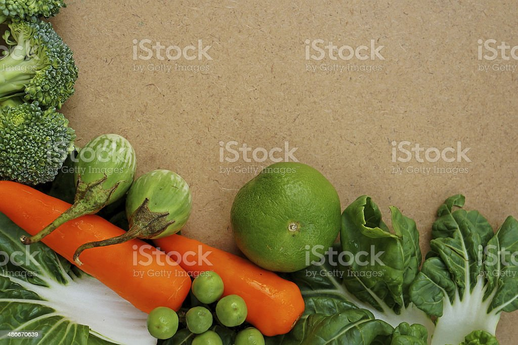 Fresh organic vegetables on wooden vintage table royalty-free stock photo