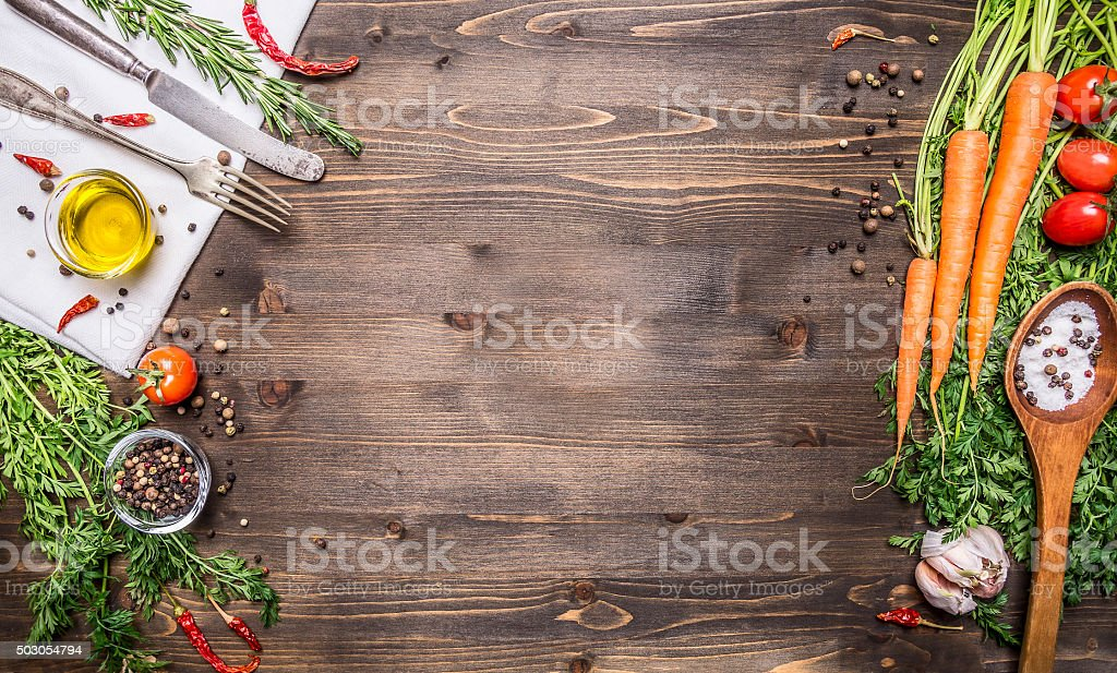 Fresh organic vegetables spoons rustic  wooden background,vegetarian cooking concept stock photo