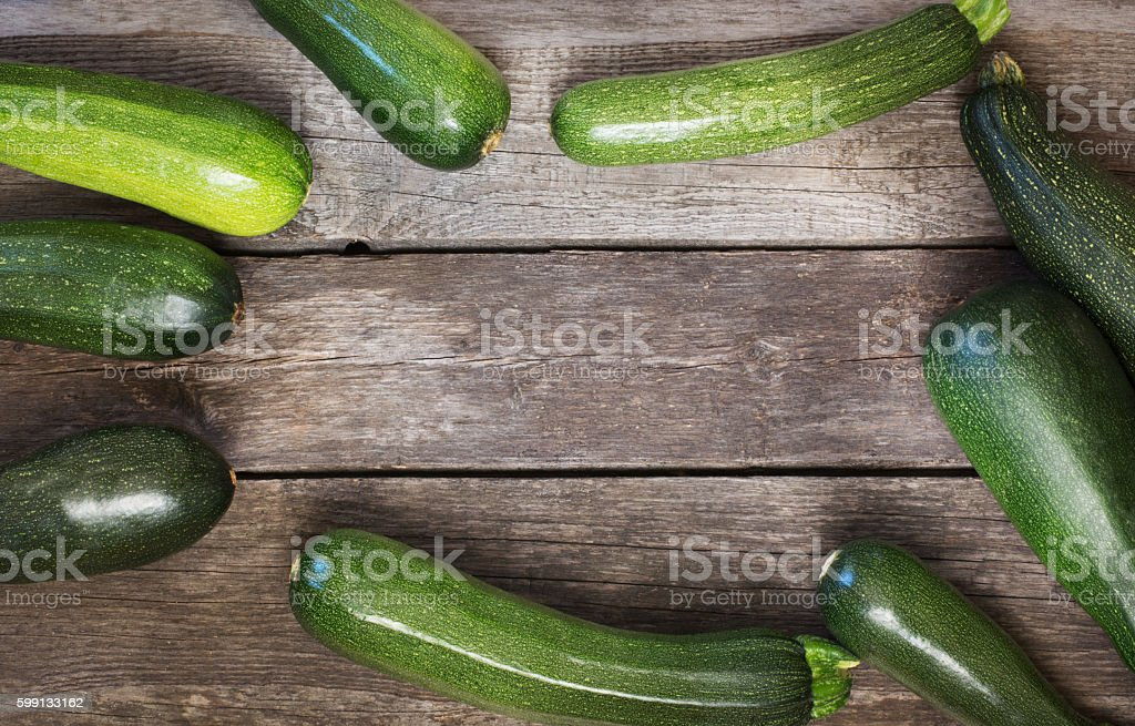 Fresh organic zucchini on the wooden table stock photo