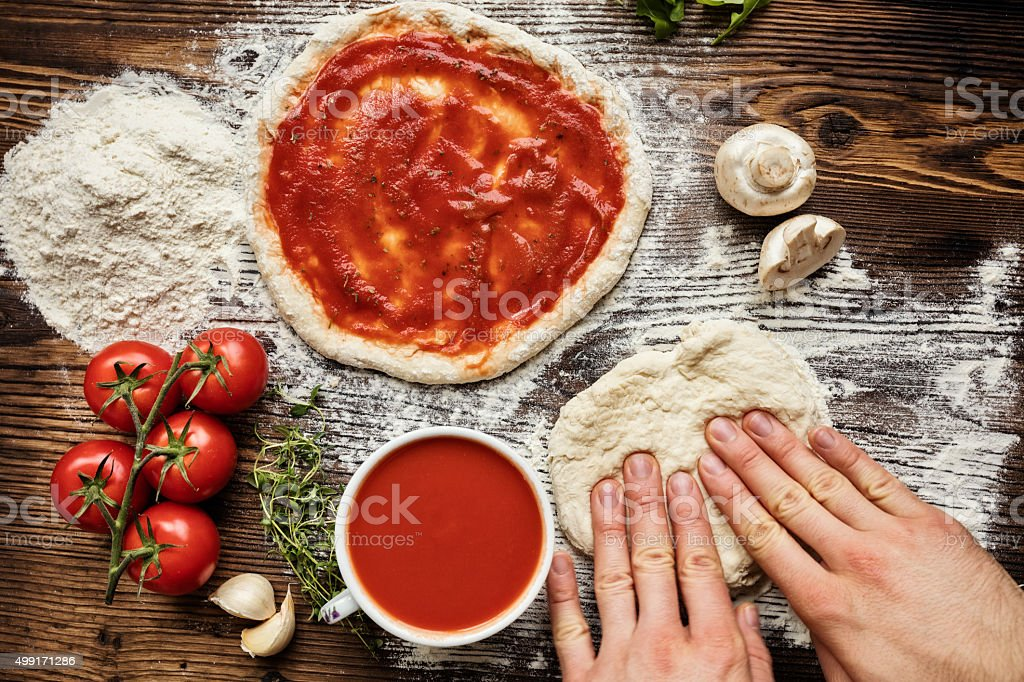 Fresh original Italian raw pizza preparation stock photo