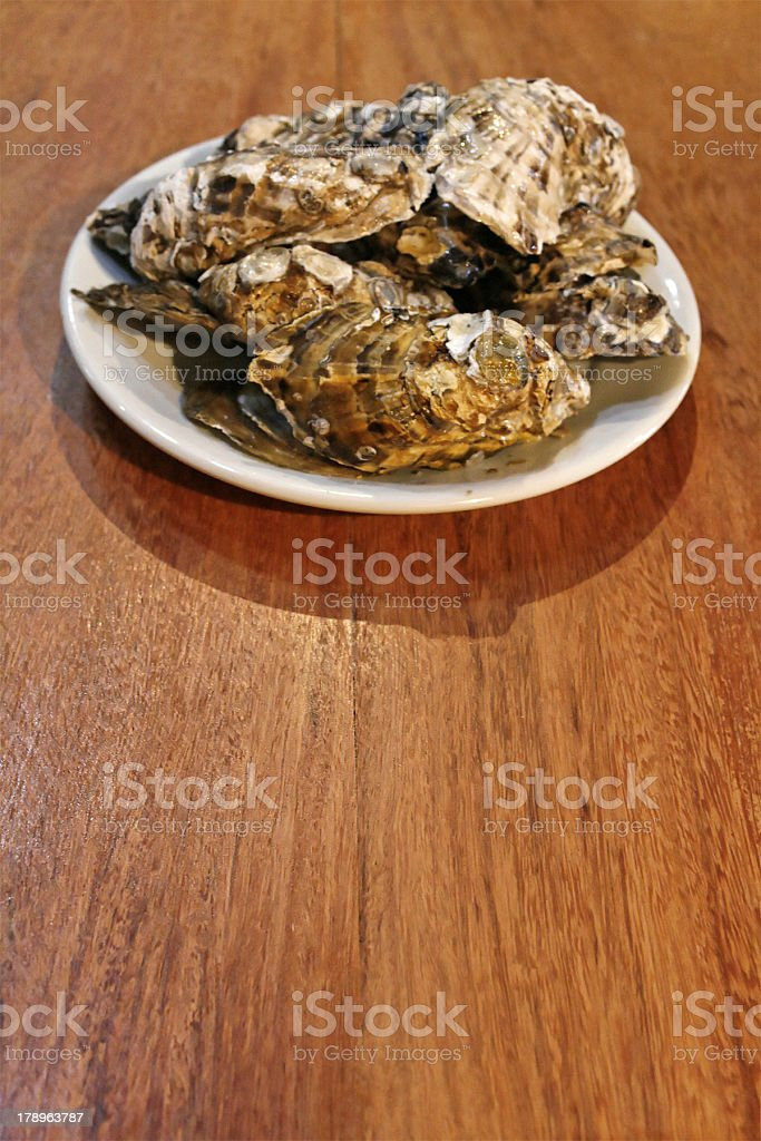 Fresh oysters plate royalty-free stock photo