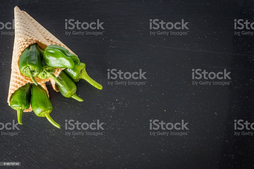 Fresh padron peppers in wafer cones stock photo