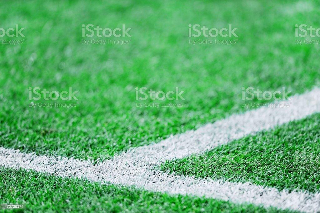 Fresh paint stripes on soccer field stock photo
